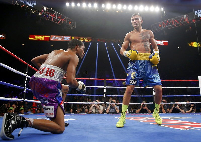 Vasyl Lomachenko of Ukraine looks on as Gamalier Rodriguez of Puerto Rico goes down in the ninth round during their 12 round WBO featherweight title fight in Las Vegas, Nevada May 2, 2015. REUTERS/Steve Marcus