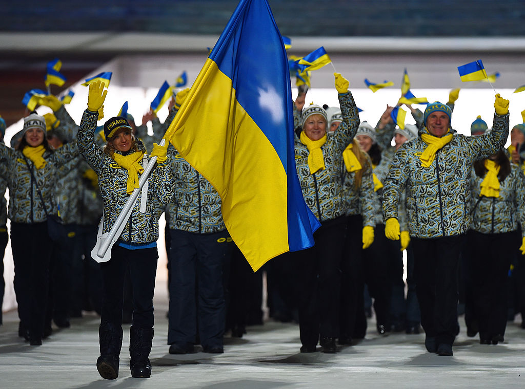 SOCHI, RUSSIA - FEBRUARY 07: Cross country skier Valentina Shevchenko of the Ukraine Olympic team carries her country's flag during the Opening Ceremony of the Sochi 2014 Winter Olympics at Fisht Olympic Stadium on February 7, 2014 in Sochi, Russia. (Photo by Pascal Le Segretain/Getty Images)