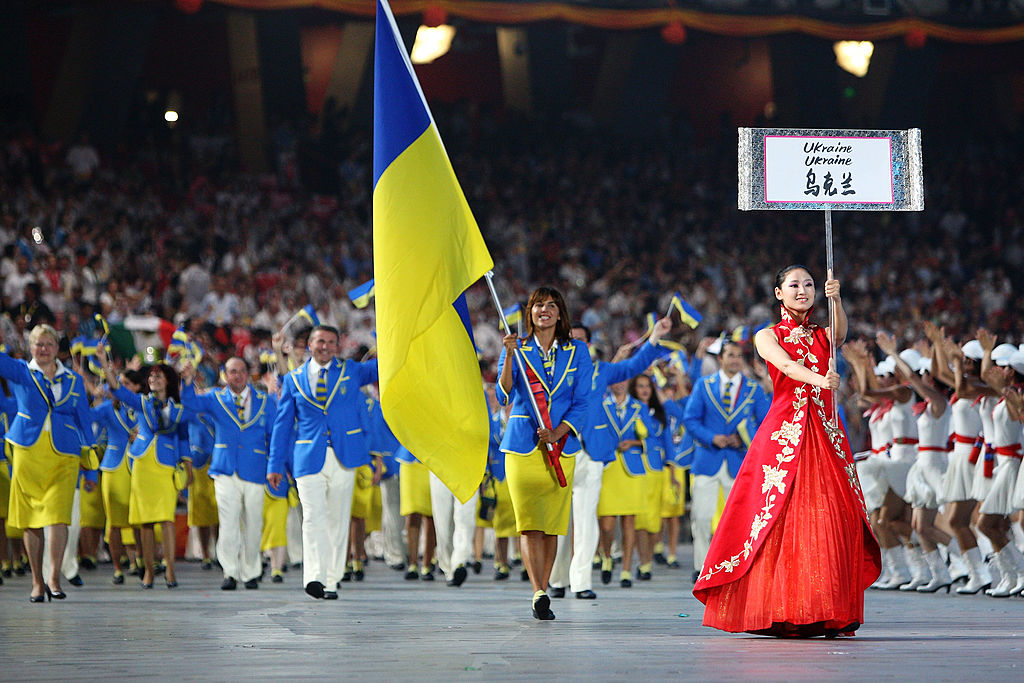BEIJING - AUGUST 08: Swimmer Yana Klochkova of Ukraine carries her country's flag during to lead out the delegation during the Opening Ceremony for the 2008 Beijing Summer Olympics at the National Stadium on August 8, 2008 in Beijing, China. (Photo by Paul Gilham/Getty Images)