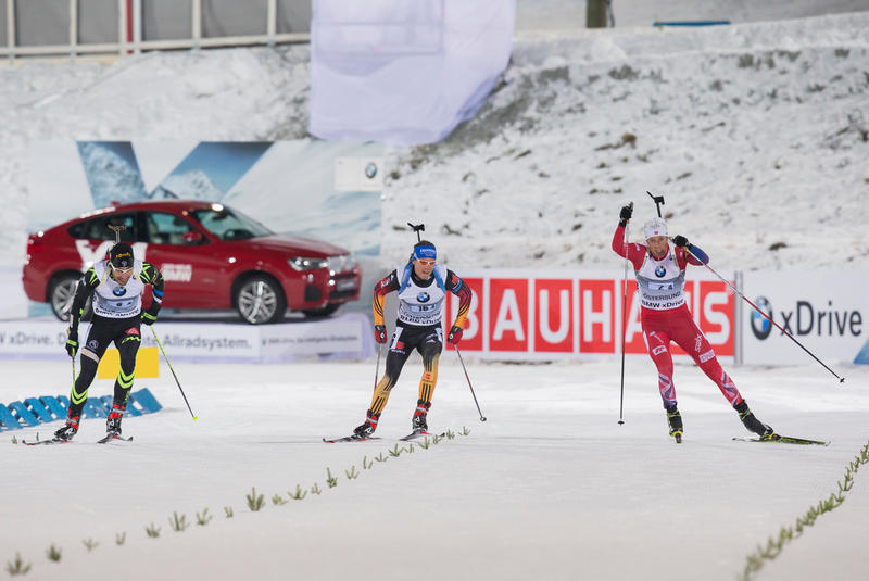30.11.2014, Oestersund, Sweden (SWE):  Martin Fourcade (FRA), Simon Schempp (GER), Lars Helge Birkeland (NOR) - IBU world cup biathlon, relay mixed, Oestersund (SWE). www.nordicfocus.com. © Manzoni/NordicFocus. Every downloaded picture is fee-liable.